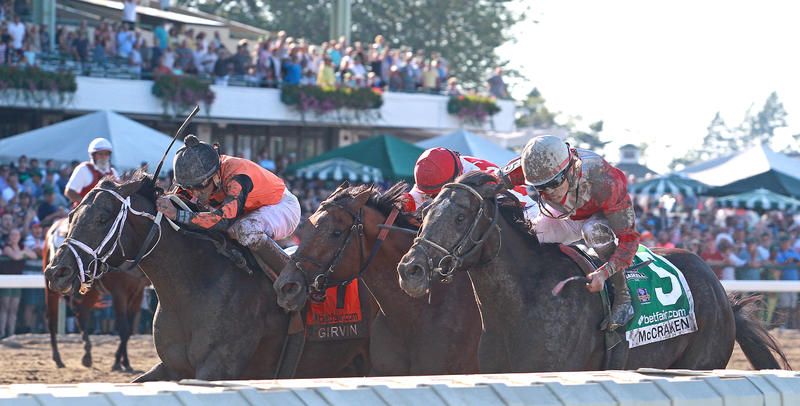 Girvin (left) surges in the final strides to catch McCraken…