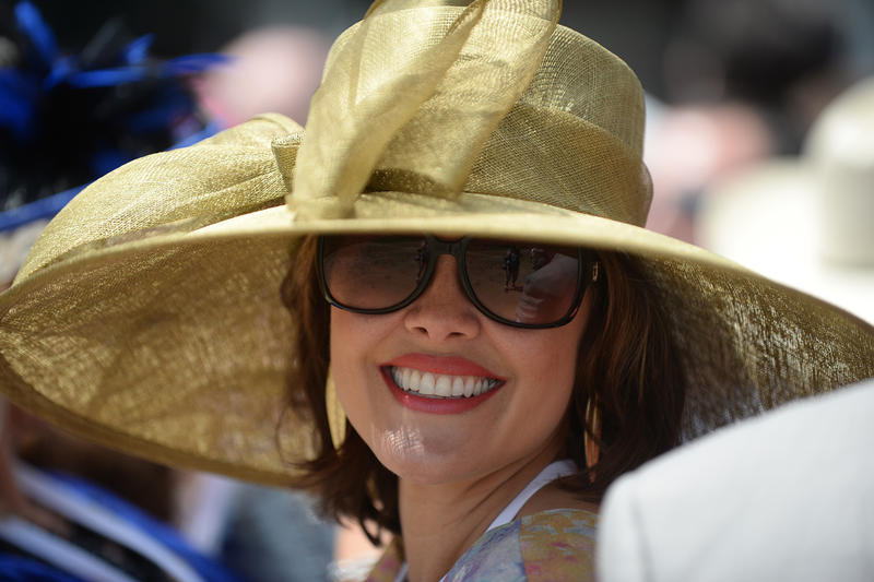 Woman in gold hat